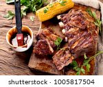 pork ribs with corn on a wooden ...   Shutterstock . vector #1005817504