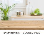 Stock photo table top with blurred kitchen interior as background 1005824437