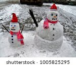 two snowmen  big and small   Shutterstock . vector #1005825295