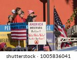 "Small photo of LOS ANGELES, CALIFORNIA - JANUARY 20, 2018: 2nd Annual Women's March marcher with a sign that reads, ""America deserves better!! Vote! Vote! Vote! Your Vote! Your Power!"""