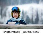 sweet preschool child  eating... | Shutterstock . vector #1005876859