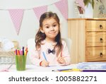 cute litter girl painting or... | Shutterstock . vector #1005882271