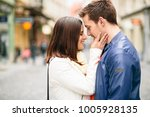 young woman about to kiss her... | Shutterstock . vector #1005928135
