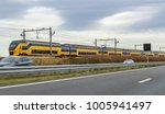 train near a highway seen in... | Shutterstock . vector #1005941497