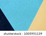 colorful cardboads on a dark... | Shutterstock . vector #1005951139