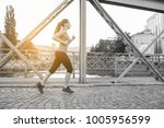 young sporty woman jogging... | Shutterstock . vector #1005956599