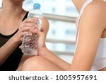 women athlete takes a break... | Shutterstock . vector #1005957691