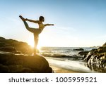 woman training yoga on the... | Shutterstock . vector #1005959521
