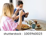 woman sitting in the restaurant ... | Shutterstock . vector #1005960025