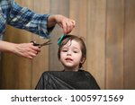 a little boy is trimmed in the... | Shutterstock . vector #1005971569