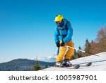 man skier in colorful gear... | Shutterstock . vector #1005987901