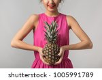 young tanned woman in pink... | Shutterstock . vector #1005991789