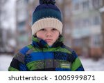 portrait of a european boy with ... | Shutterstock . vector #1005999871