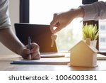 key of home on hand of bank... | Shutterstock . vector #1006003381