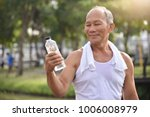 asian senior male holding... | Shutterstock . vector #1006008979