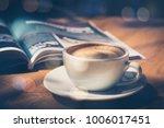 cup of coffee in cafe in dark...   Shutterstock . vector #1006017451