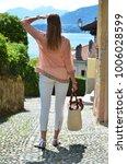 girl on the cobbled street of... | Shutterstock . vector #1006028599