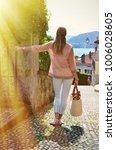 girl on the cobbled street of... | Shutterstock . vector #1006028605