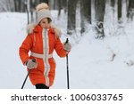 young girl skier walking in the ... | Shutterstock . vector #1006033765