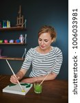 woman painting win hobby room...   Shutterstock . vector #1006033981