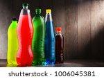 plastic bottles of assorted... | Shutterstock . vector #1006045381