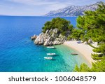 beautiful beach near brela town ... | Shutterstock . vector #1006048579