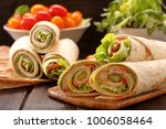 fresh tortilla wraps with ham... | Shutterstock . vector #1006058464