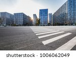 empty road with modern business ... | Shutterstock . vector #1006062049