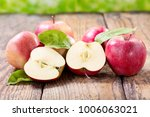 fresh red apples with leaves on ... | Shutterstock . vector #1006063021