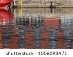 Small photo of Lübeck, reflection of the old fireship in the harbor water