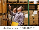 manager and warehouse worker... | Shutterstock . vector #1006100131