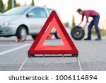 man changing a flat tyre after... | Shutterstock . vector #1006114894