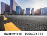 empty road with modern business ... | Shutterstock . vector #1006136785
