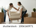 young couple carrying chair... | Shutterstock . vector #1006160971
