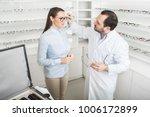 woman chooses eyeglasses to... | Shutterstock . vector #1006172899