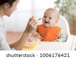 young mother feeding her baby... | Shutterstock . vector #1006176421
