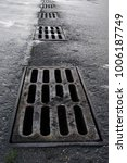Small photo of storm drainage on the road