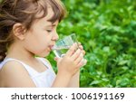 child glass of water. selective ... | Shutterstock . vector #1006191169