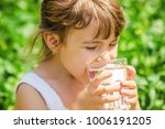 child glass of water. selective ... | Shutterstock . vector #1006191205