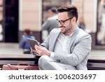 relaxed businessman using his...   Shutterstock . vector #1006203697