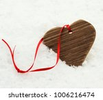 wooden heart with red ribbon on ...   Shutterstock . vector #1006216474
