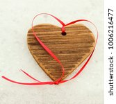 wooden heart with red ribbon on ...   Shutterstock . vector #1006216477