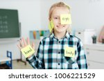 happy schoolgirl having sticky...   Shutterstock . vector #1006221529