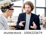 young manager explaining his... | Shutterstock . vector #1006223674