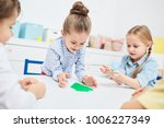 adorable little girls playing... | Shutterstock . vector #1006227349