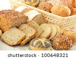 Composition with bread and rolls in wicker basket on the table - stock photo