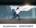 female athlere running. sporty... | Shutterstock . vector #1006533805