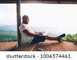 young caucasian man freelancer... | Shutterstock . vector #1006574461