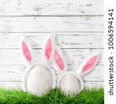 easter bunnies in green grass.... | Shutterstock . vector #1006594141