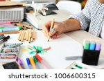 man draws with a pencil on... | Shutterstock . vector #1006600315